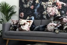 16 a moody floral wall and matching pillows to tie the look up