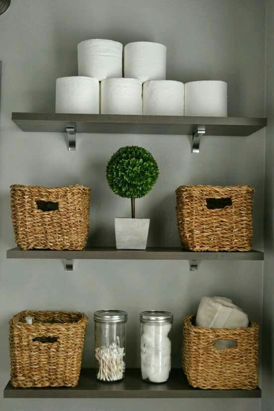 baskets for storage are a cute idea for a farmhouse bathroom
