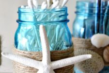 17 blue mason jars with twine and starfish decor for stroing bathroom supplies