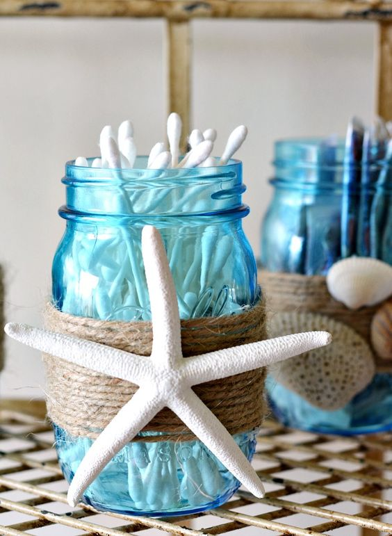 blue mason jars with twine and starfish decor for stroing bathroom supplies