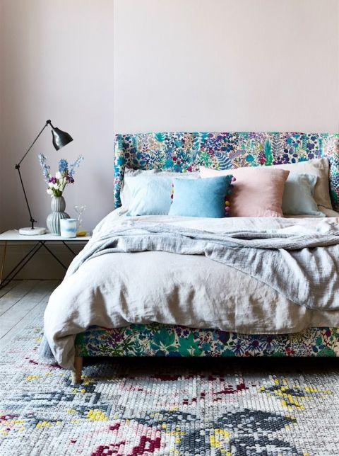 colorful leaf and floral printed bed upholstery in greens and blues