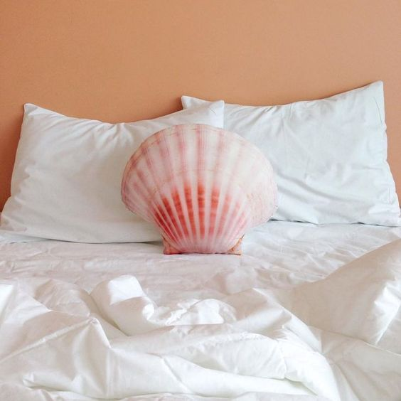coral colored seashell throw pillow