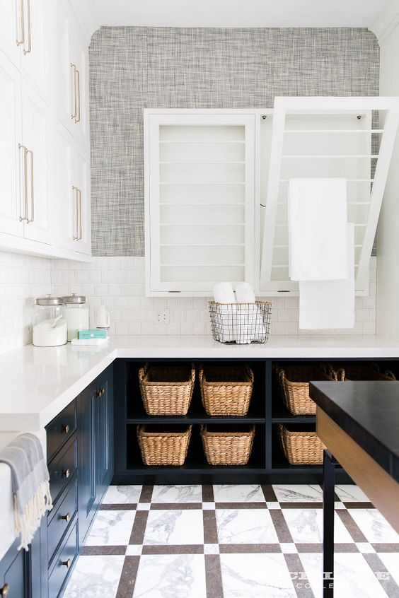 baskets for storage in a laundry room add interest to the space