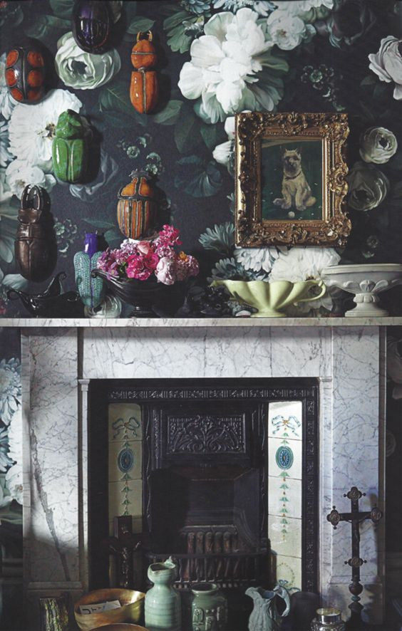 dark floral wallpaper on the fireplace wall to make an accent