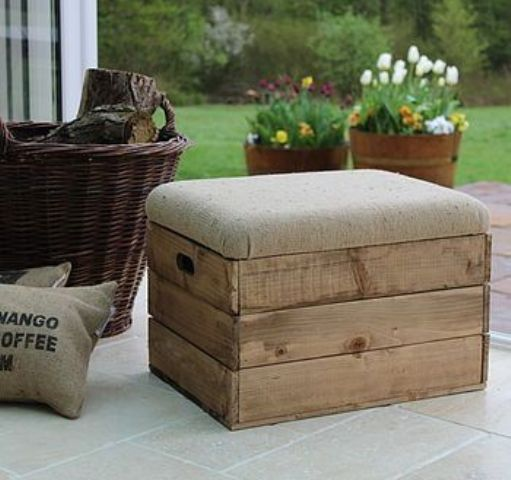 upholstered crate stool with storage space inside it
