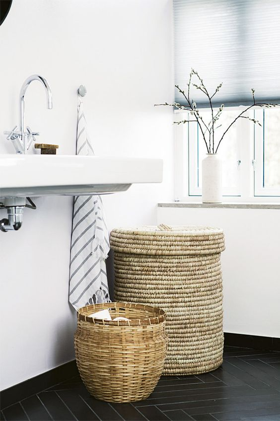 baskets for towel storage in the bathroom is a great and fresh idea