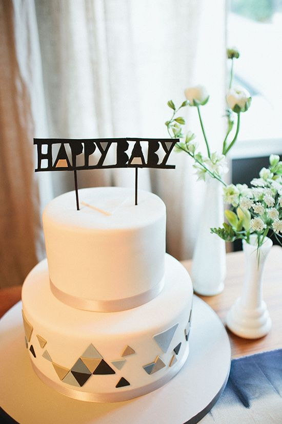 decorate your shower cake with colorful triangles and a cool topper