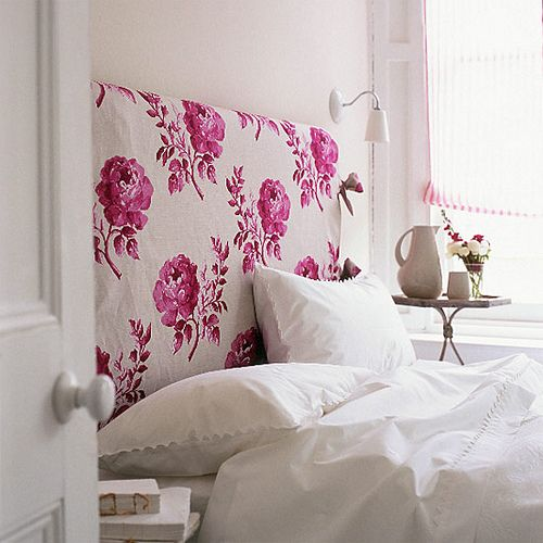 cute creamy headboard with a pink rose print for a feminine bedroom