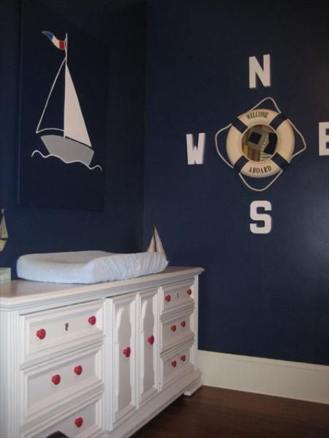 seaside wall decor with a boat and a life saver