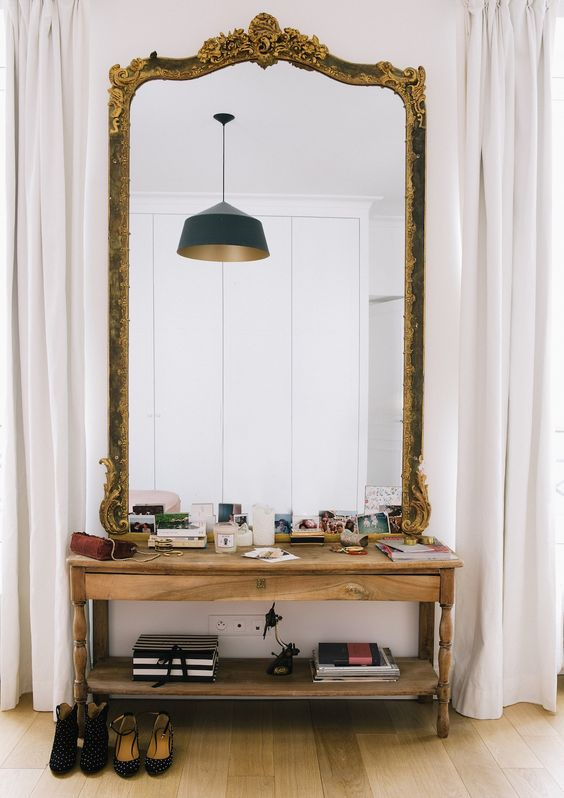 oversized mirror in a refined frame with detailing