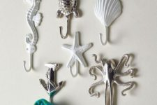21 sea reature towel hooks are an easy and cheap idea to add an ocean flavor to the decor