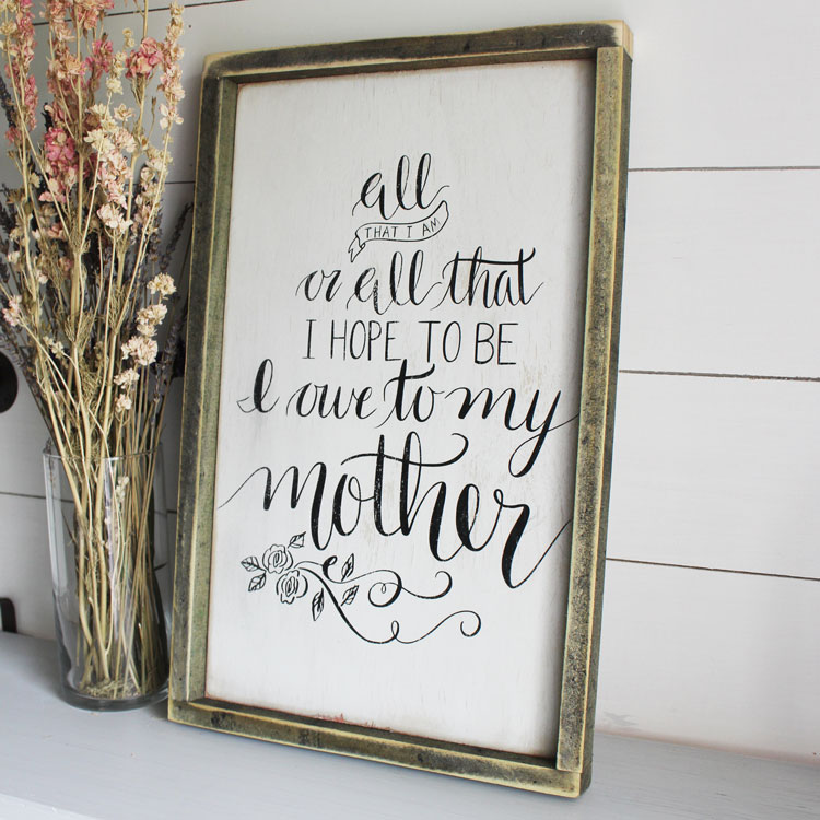 DIY vintage-inspired Mother's Day sign in a weathered wood frame (via thesummeryumbrella.com)