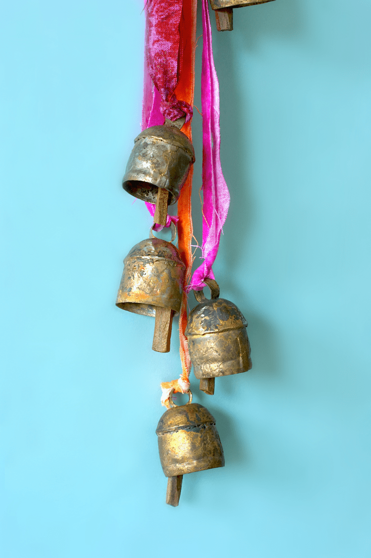 DIY boho wind chimes with colorful straps decor (via www.acharmingproject.com)