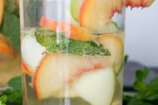 DIY white sangria with whiskey, apple and peach