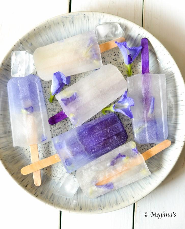 DIY blue ombre edible flower popsicles (via meghnas.com)
