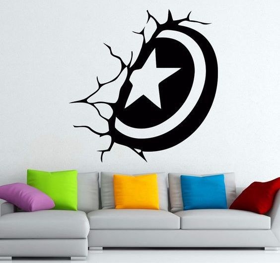 a black and white wall decal that looks like a Captain America shield stuck in the wall