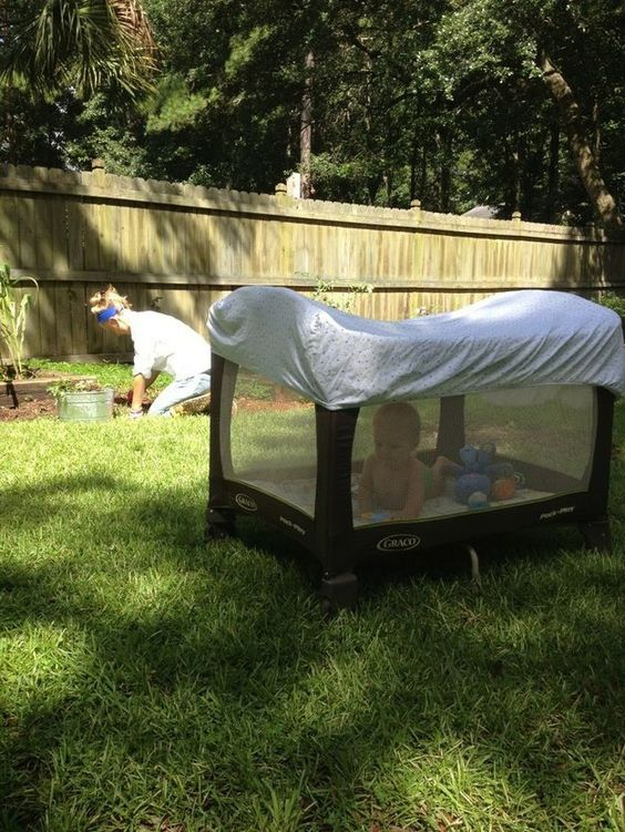 a portable crib covered on top to keep your child safe