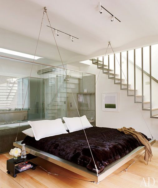 a metal hanging bed for a modern open space bedroom