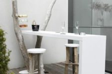 05 a white built-in tabletop and wood and plastic stools for a small dining space
