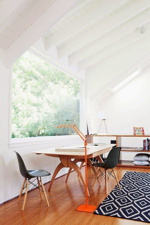 mid-century modern office with a panorama window and forest views