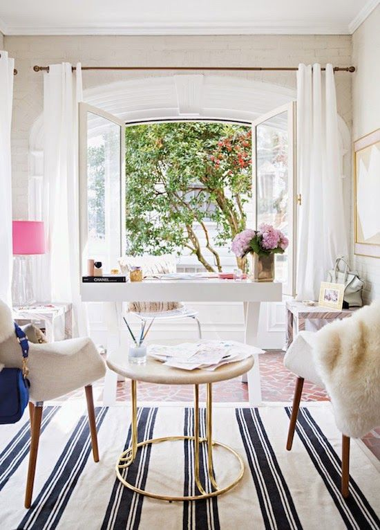a girlish and glam home office with opened framed window that invite to the garden