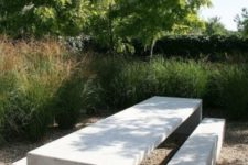 08 a concrete dining set in the garden is very durable and practical