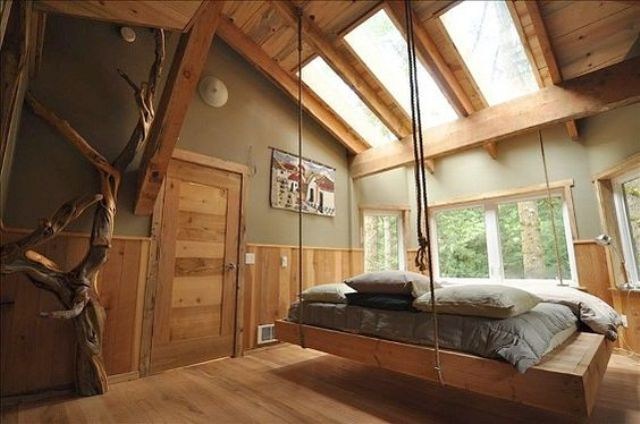 modern wooden hanging bed in a natural bedroom with skylights