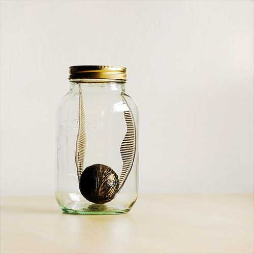 a golden snitch in a jar can be DIYed and can become a cute home decoration