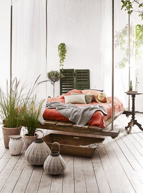 pallet and rope hanging bed in a boho Mediterranean bedroom