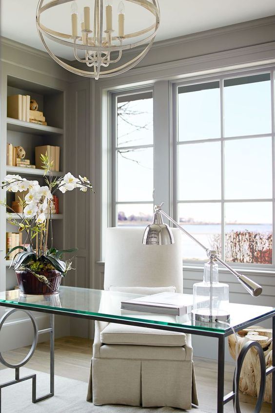 elegant home office with a retro feel and a large window with sea views