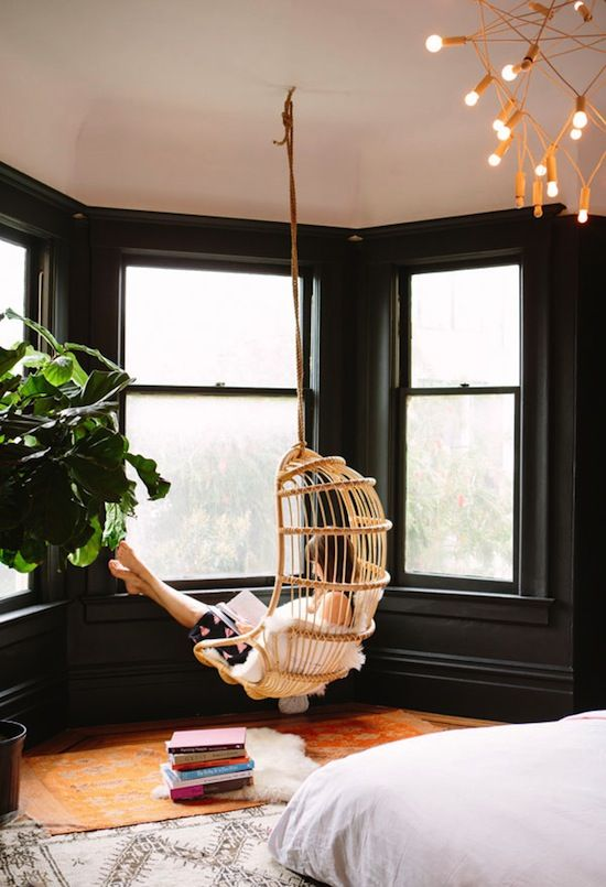 hang a neutral wicker chair in front of windows to enjoy the view
