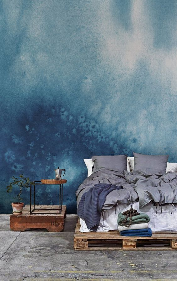 such blue watercolor wallpaper gives the bedroom a slight seaside feel