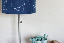 11 a lamp with a navy constellation lampshade is an eye-catchy piece