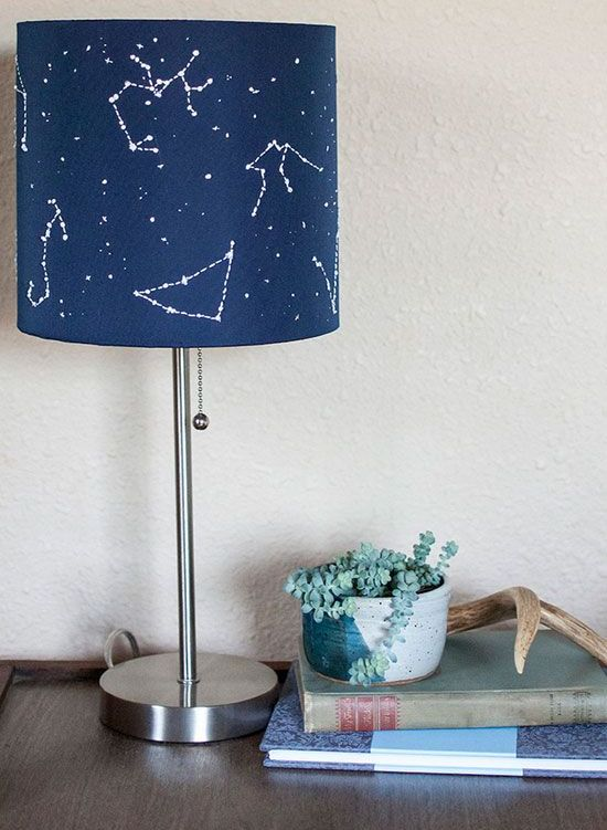 a lamp with a navy constellation lampshade is an eye-catchy piece