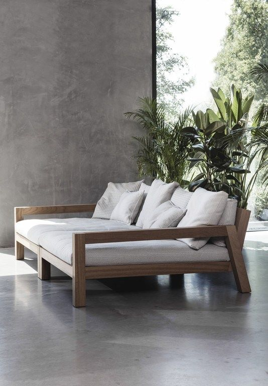 a modern wooden loveseat with armrests and comfy upholstery