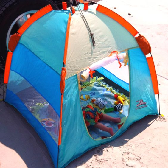 colorful blue and orange outdoor tent filled with toys to keep your kid busy