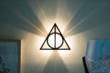 11 framed triangle from the Deathly Hallows as a wall lamp