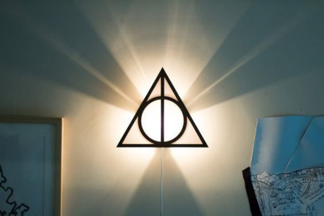 framed triangle from the Deathly Hallows as a wall lamp