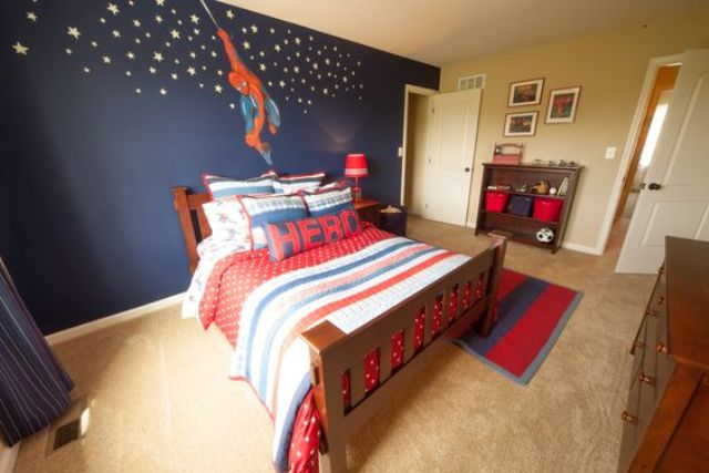 Spiderman wall decor with stars and matching bedding with a hero pillow