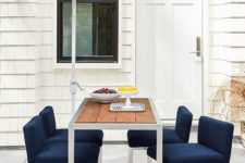 12 a narrow counter table and upholstered navy stools for a very small space
