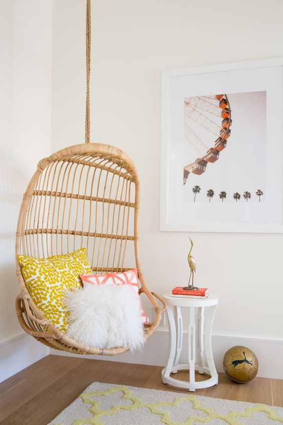 a rattan suspended chair is great for a teenage girl bedroom