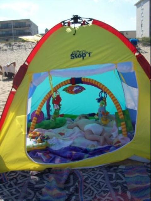 colorful outdoor tent for a baby is a great solution to go to the beach