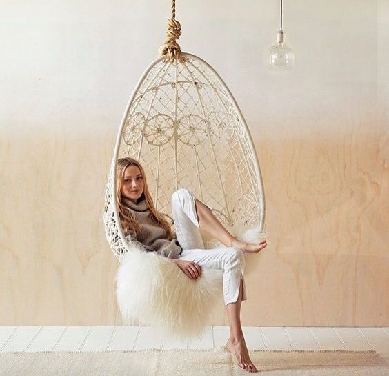 a gorgeous gypsy-inspired white egg-shaped chair for a boho interior