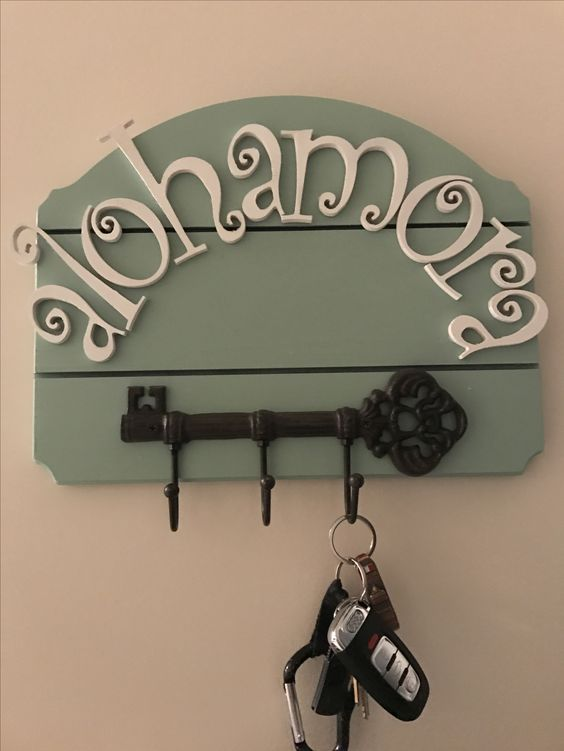 a key holder with a large vintage key and Alohamora spell