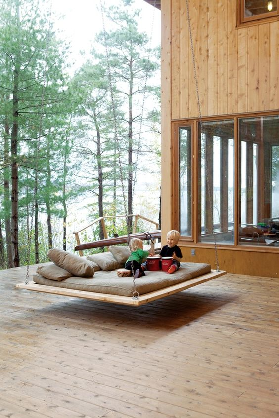 a large hanging bed for several people hung on the deck will be loved by kids