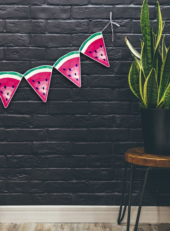 a paper watermelon garland will cheer up any space and you can make it fast