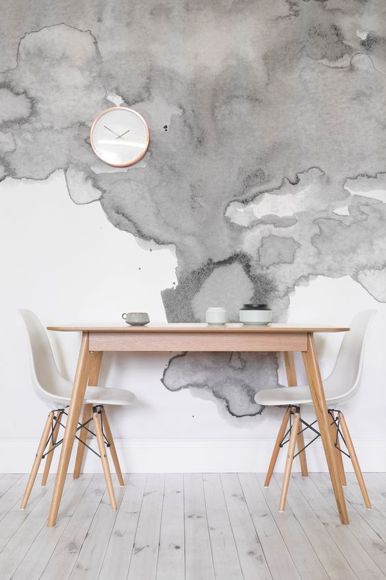 grey watercolor wallpaper adds interest to this neutral dining space