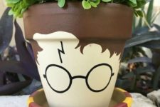 15 a planter painted as Harry Potter in a scarf