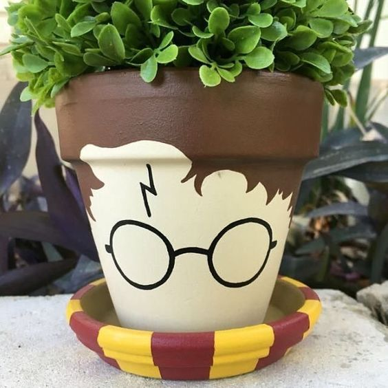 a planter painted as Harry Potter in a scarf
