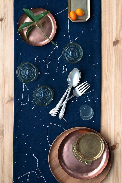 a navy constellation table runner looks amazing with copper dishes